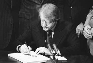 "Jimmy Carter signing off on the ""Love Canal Bill"""